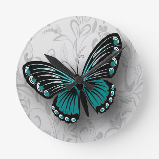 Whimsical Teal Butterfly on Gray Floral Round Clock