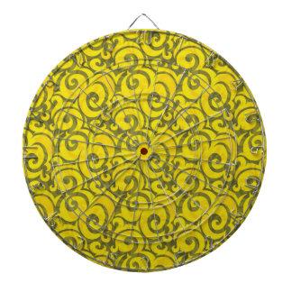 whimsical yellow pattern dartboard with darts