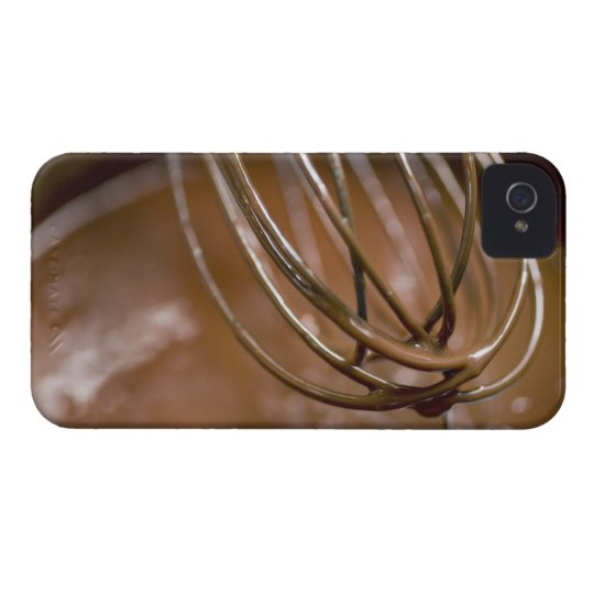 Whisking the chocolate in a saucepan to melt the iPhone 4 Case-Mate case