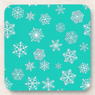 White 3-d snowflakes on a turquoise background drink coaster