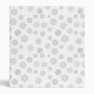 White 3-d snowflakes on a white background binder
