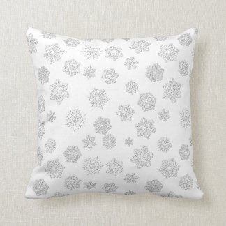 White 3-d snowflakes on a white background pillow