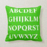 WHITE ALPHABET on  green plain pillow