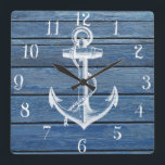 "White Anchor And Vintage Blue Wood Square Wall Clock<br><div class=""desc"">A white anchor and vintage faded blue wood panels.A popular design on wood texture background. The perfect unique gift for every occasion</div>"