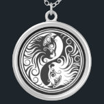 """White and Black Yin Yang Cats Silver Plated Necklace<br><div class=""""desc"""">This unique yin yang design features two stylized kittens. The faces of the two cats appear in the large teardrops of the yin yang with long flowing lines tapering up and down to the two tips. This stylish kitten design is a fun and unique example of this symbol for the...</div>"""