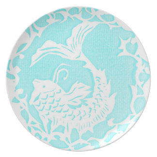 white and blue fish themed plate