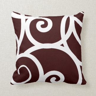 white and brown abstract pattern pillow