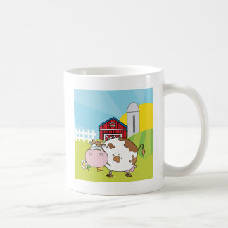 White and brown cow in front of farm scene coffee mug