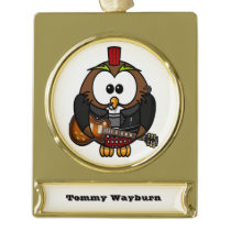 White and brown owl playing a guitar with red hat gold plated banner ornament
