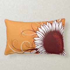 White and Burgundy Flower on Orange Pillows