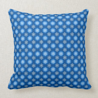 White and Light Blue Snowflakes on Dark Blue Pillow