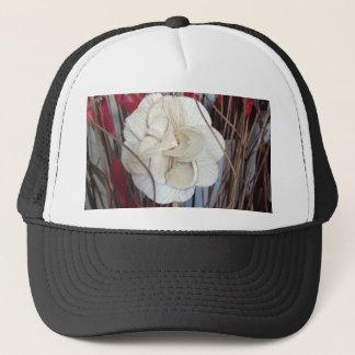 white and red flower arrangement trucker hat