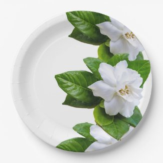 White beautiful gardenia flowers on white paper plate