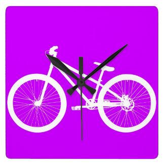 White Bike on Purple Square Wall Clocks