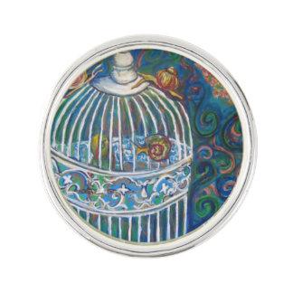 white bird cage snail lapel pin