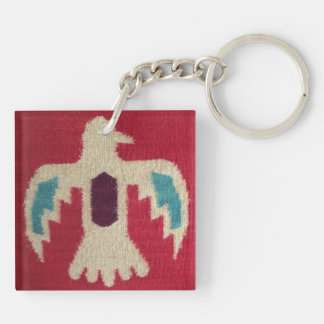 white bird image with blue wings and maroon back keychain