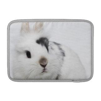White, black and brown rabbit MacBook sleeves