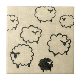 White & Black Sheep on Cream Background Ceramic Tile