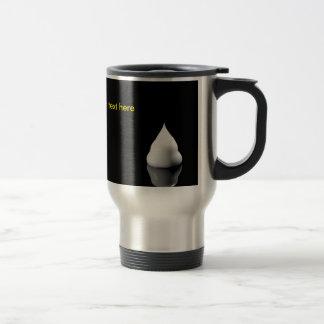 white blob of cream is reflected in black backgrou travel mug