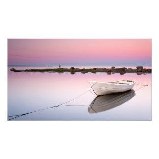 White boat at a beautiful sunset photo
