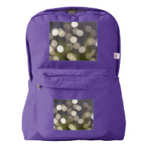 White Bokeh Lights on Purple Backpack