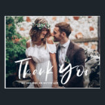 """White Brush Hand Lettered Photo Wedding Thank You Postcard<br><div class=""""desc"""">White Brush Hand Lettered Photo Wedding Thank You Postcard. Stylish hand lettered photo thank you postcard featuring a beautiful brush script. This two-photo thank you card will be perfect for a variety of events such as weddings and graduations. Personalize by adding your favorite horizontal photos. Available as a flat or...</div>"""