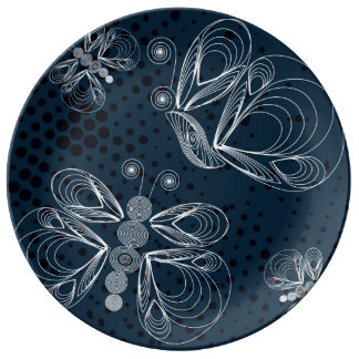 White butterflies on navy blue grunge background dinner plate