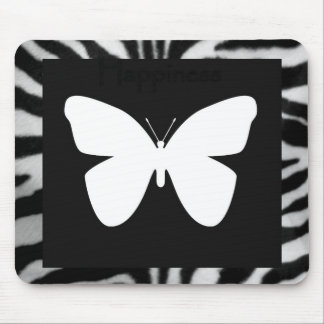 White butterfly on zebra mouse pad