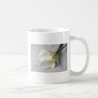 white calla lilies on decorative cloth coffee mug