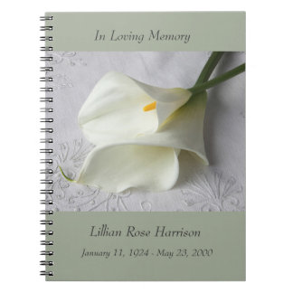 White calla lilies on linen note book