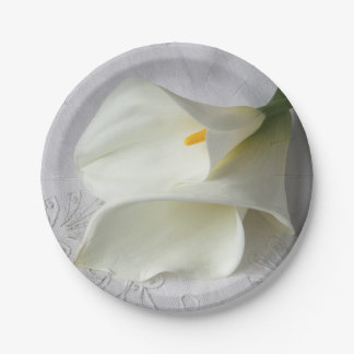 White calla lilies on linen paper plate