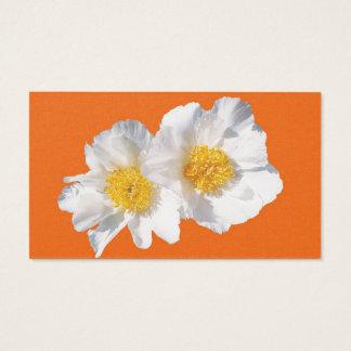 white camellia on orange business card