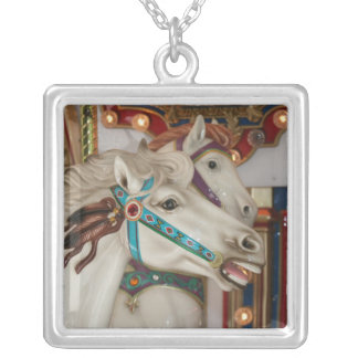 White carousel horse with blue bridle picture pendants