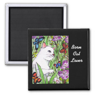 White cat chasing butterflies amongst flowers 2 inch square magnet
