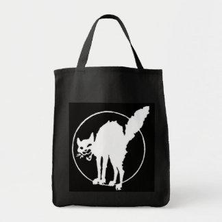 white cat on black tote bag