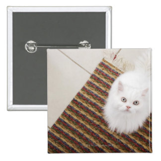 White cat sitting on mat 2 inch square button