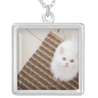 White cat sitting on mat silver plated necklace