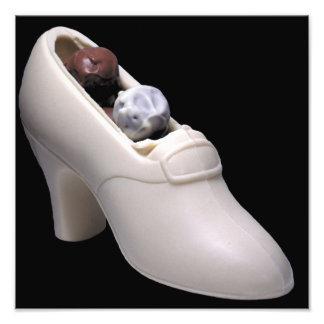 White chocolate shoe with truffles art photo