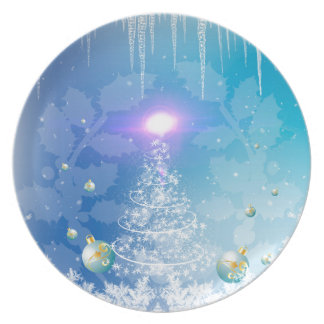 White christmas tree with a light effect, party plates