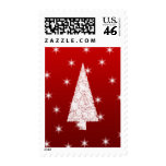 White Christmas Tree with Stars on Red. Stamp
