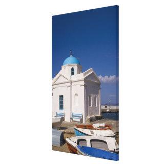 White church on the beach near the Aegean Sea on Canvas Print