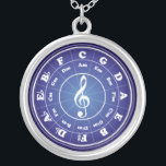 """White Circle of Fifths Silver Plated Necklace<br><div class=""""desc"""">White Musical Circle of Fifths on a background which looks like a round blue sapphire. A treble clef,  or G clef,  is in the center of the graphic (and necklace).</div>"""