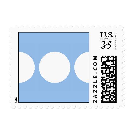 White Circles on Light Blue Postage