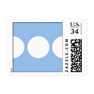 White Circles on Light Blue Postage Stamp