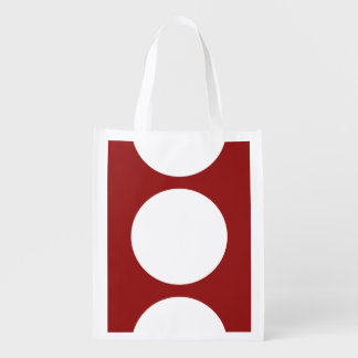 White Circles on Red Grocery Bags