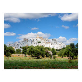 White city Ostuni and olive trees, Puglia postcard