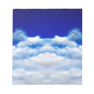 White cloud face against a blue sky notepad