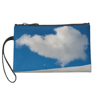 White cloud on a twinkling snowy hill wristlet clutches