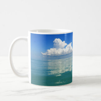 White cloud over a placid ocean coffee mug