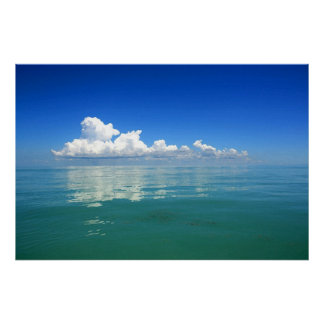 White cloud over a placid ocean poster